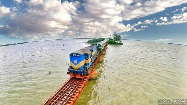 A train of Dhaka to Jamalpur route is running over the haor. porzoton.com